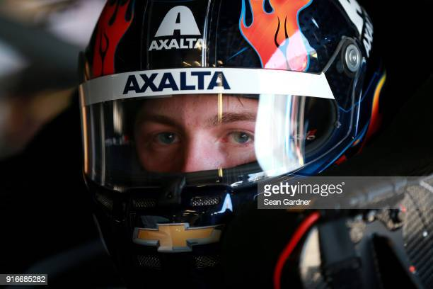 William Byron driver of the AXALTA Chevrolet sits in his car during practice for the Monster Energy NASCAR Cup Series Daytona 500 at Daytona...