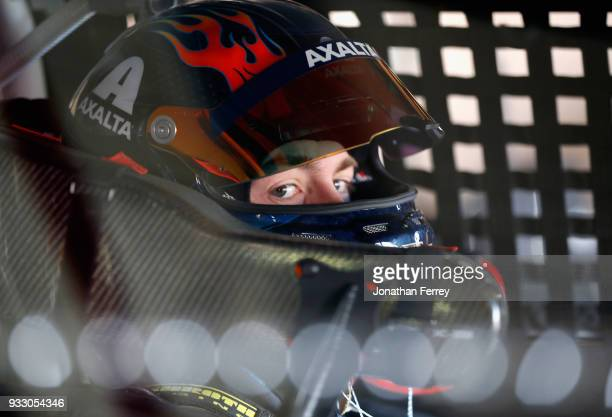 William Byron driver of the AXALTA Chevrolet sits in his car during practice for the Monster Energy NASCAR Cup Series Auto Club 400 at Auto Club...