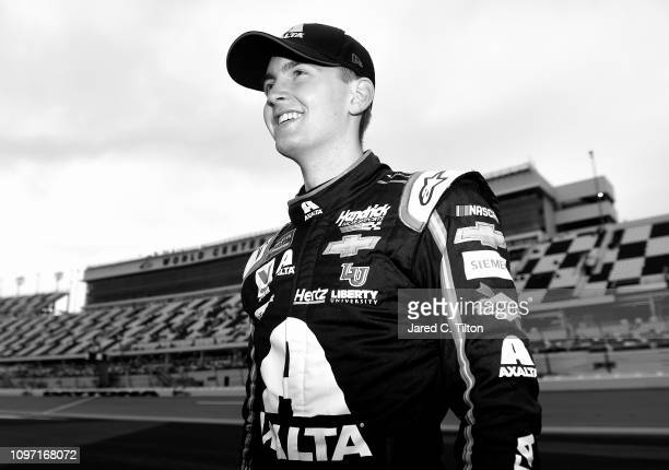 William Byron driver of the Axalta Chevrolet stands on the grid after posting the fastest lap during qualifying for the Monster Energy NASCAR Cup...