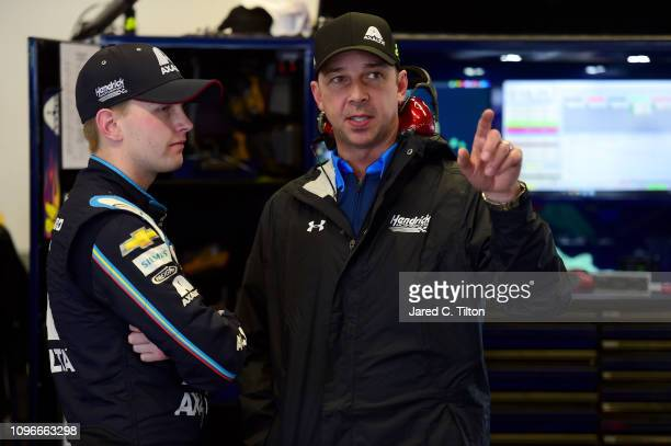 William Byron driver of the Axalta Chevrolet talks with crew chief Chad Knaus during practice for the Monster Energy NASCAR Cup Series 61st Annual...