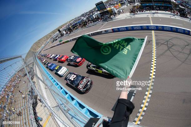 William Byron driver of the Axalta/Ameristar Chevrolet and Erik Jones driver of the Reser's Main St Bistro Toyota take the green flag to start the...