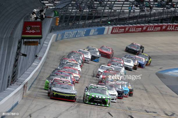 William Byron driver of the AXALTA/Central Aluminum Chevrolet and Daniel Suarez driver of the Interstate Batteries Toyota lead the field to the green...