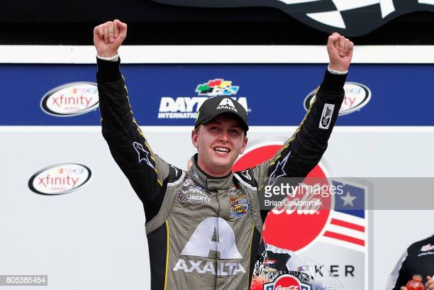 William Byron driver of the AXALTA/Vorteq Chevrolet celebrates in Victory Lane after winning the NASCAR XFINITY Series CocaCola Firecracker 250 at...