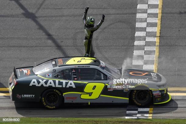 William Byron driver of the AXALTA/Vorteq Chevrolet celebrates winning the NASCAR XFINITY Series CocaCola Firecracker 250 at Daytona International...