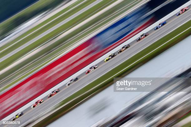 William Byron driver of the AXALTA/Vorteq Chevrolet leads a pack of cars during the NASCAR XFINITY Series CocaCola Firecracker 250 at Daytona...