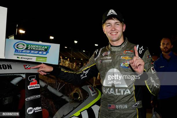William Byron driver of the AXALTA/WINDSORWindowDoor Chevrolet poses with the winners decal after winning the NASCAR XFINITY Series American Ethanol...