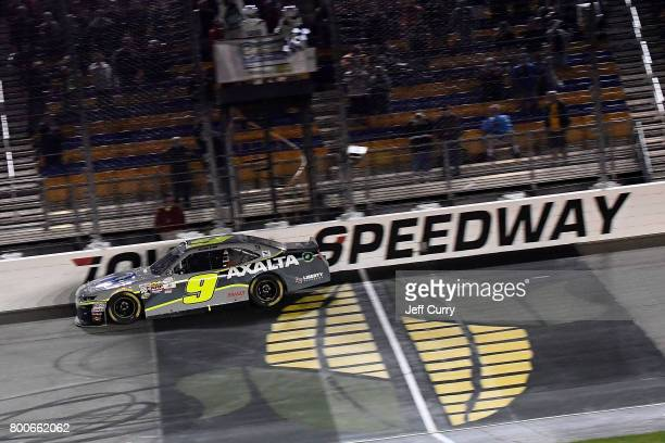 William Byron driver of the AXALTA/WINDSORWindowDoor Chevrolet takes the checkered flag to win the NASCAR XFINITY Series American Ethanol E15 250 at...