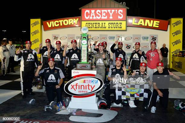William Byron driver of the AXALTA/WINDSORWindowDoor Chevrolet celebrates with his team in Victory Lane after winning the NASCAR XFINITY Series...