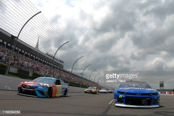 William Byron driver of the Hendrick Autoguard Chevrolet and Kyle Busch driver of the MM's Hazelnut Toyota lead the field prior to the start of the...