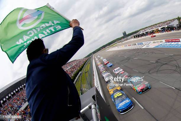 William Byron driver of the Hendrick Autoguard Chevrolet and Kyle Busch driver of the MM's Hazelnut Toyota lead the field to the green flag to start...