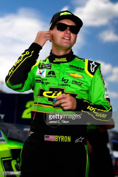 William Byron driver of the HendrickAutoguard/CityChverolet Chevrolet Throwback stands on the grid during qualifying for the Monster Energy NASCAR...