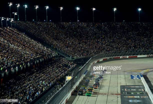 William Byron driver of the HendrickAutoguard/CityChvrltThrwbck Chev and Brad Keselowski driver of the Miller Lite Ford lead the field to the green...