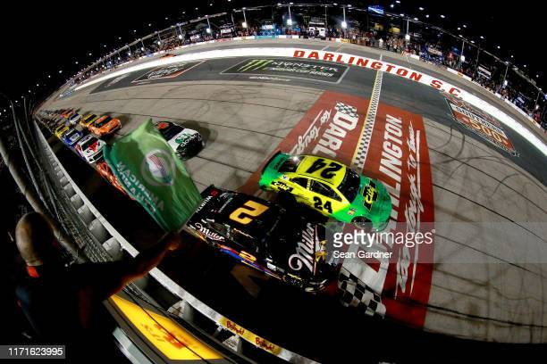 William Byron driver of the HendrickAutoguard/CityChvrltThrwbck Chev leads the field to start the Monster Energy NASCAR Cup Series Bojangles'...