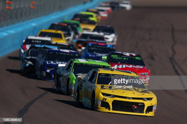 William Byron driver of the Hertz Chevrolet leads a group of cars during the Monster Energy NASCAR Cup Series CanAm 500 at ISM Raceway on November 11...