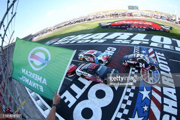 William Byron driver of the Liberty Patriotic Chevrolet and Aric Almirola driver of the Smithfield Ford lead the field to the green flag to start the...
