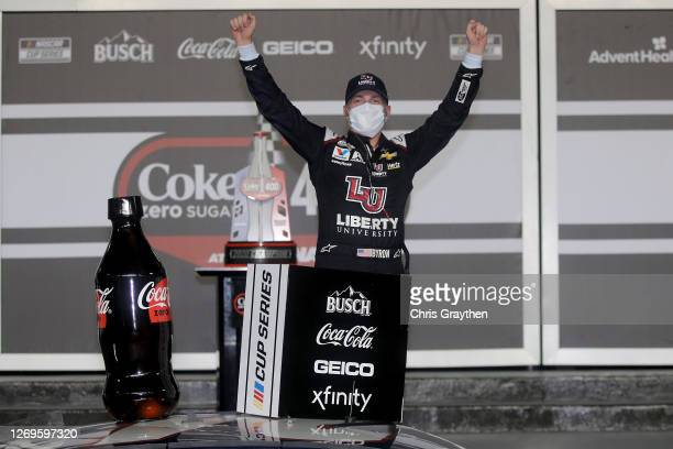 William Byron driver of the Liberty University Chevrolet celebrates in Victory Lane after winning the NASCAR Cup Series Coke Zero Sugar 400 at...