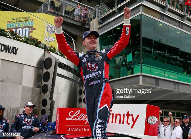 William Byron driver of the Liberty University Chevrolet celebrates in victory lane after winning the NASCAR XFINITY Series Lilly Diabetes 250 at...