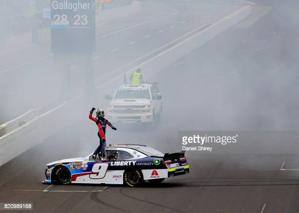 William Byron driver of the Liberty University Chevrolet celebrates winning the NASCAR XFINITY Series Lilly Diabetes 250 at Indianapolis...