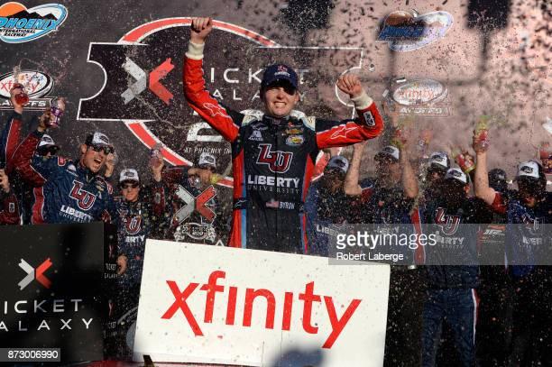 William Byron driver of the Liberty University Chevrolet celebrates in victory lane after winning the NASCAR XFINITY Series Ticket Galaxy 200 at...