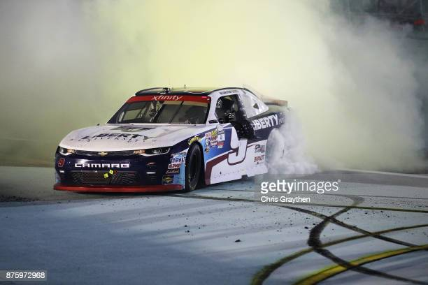 William Byron driver of the Liberty University Chevrolet celebrates with a burnout after placing third and winning the NASCAR XFINITY Series...