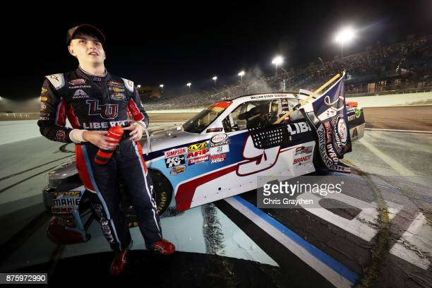 William Byron driver of the Liberty University Chevrolet celebrates after placing third and winning the NASCAR XFINITY Series Championship during the...