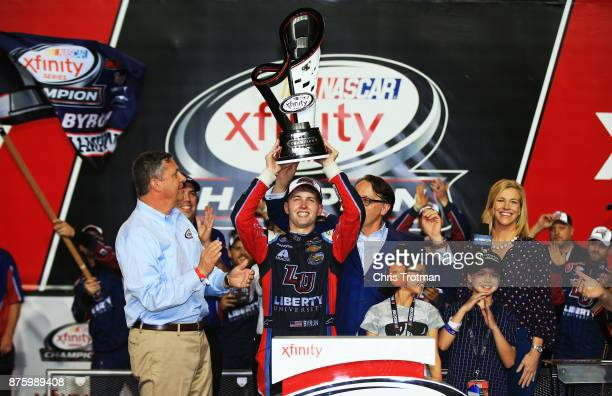 William Byron driver of the Liberty University Chevrolet celebrates in Victory Lane after placing third and winning the NASCAR XFINITY Series...