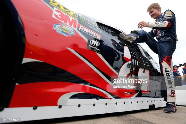 William Byron driver of the Liberty University Chevrolet climbs into his car during qualifying for the Monster Energy NASCAR Cup Series O'Reilly Auto...