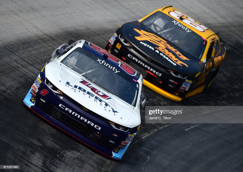 William Byron, driver of the #9 Liberty University Chevrolet, drives in front of Brendan Gaughan, driver of the #62 South Point Hotel & Casino Chevrolet, during practice for the NASCAR XFINITY Series Fitzgerald Glider Kits 300 at Bristol Motor Speedway on April 21, 2017 in Bristol, Tennessee.