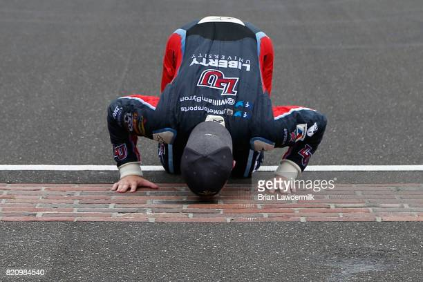 William Byron driver of the Liberty University Chevrolet kisses the yard of bricks after winning the NASCAR XFINITY Series Lilly Diabetes 250 at...