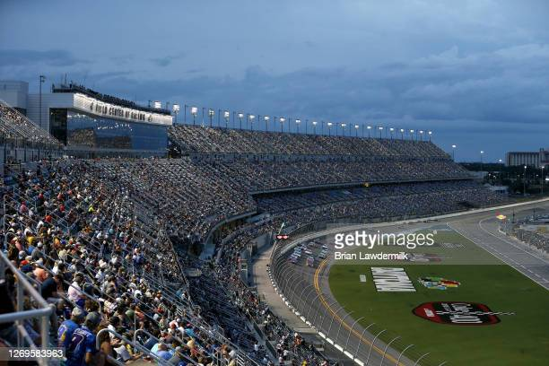 William Byron, driver of the Liberty University Chevrolet, leads a pack of cars during the NASCAR Cup Series Coke Zero Sugar 400 at Daytona...