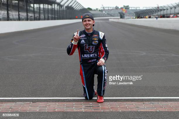 William Byron driver of the Liberty University Chevrolet poses with the yard of bricks after winning the NASCAR XFINITY Series Lilly Diabetes 250 at...