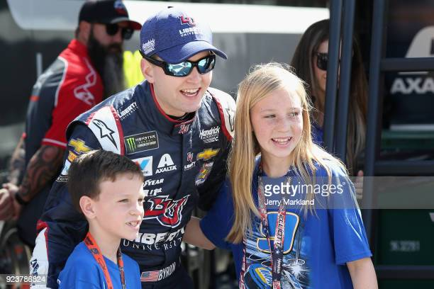 William Byron driver of the Liberty University Chevrolet poses with fans during practice for the Monster Energy NASCAR Cup Series Folds of Honor...