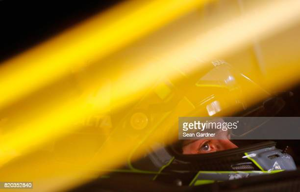 William Byron driver of the Liberty University Chevrolet sits in his car during practice for the NASCAR XFINITY Series Lilly Diabetes 250 at...