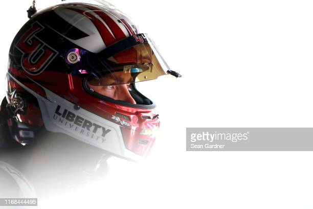 William Byron driver of the Liberty University Chevrolet stands in the garage during practice for the Monster Energy NASCAR Cup Series Bass Pro Shops...