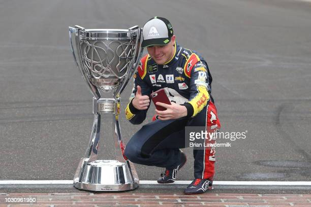 William Byron driver of the Liberty University Chevrolet takes a photo with the Monster Energy NASCAR Cup Series trophy after making the playoffs...