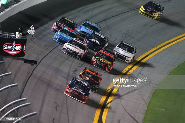 William Byron driver of the Liberty University Chevrolet takes the checkered flag to win the NASCAR Cup Series Coke Zero Sugar 400 at Daytona...