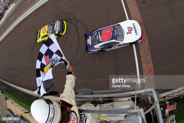 William Byron, driver of the Liberty University Chevrolet, takes the checkered flag to win the NASCAR XFINITY Series Lilly Diabetes 250 at...