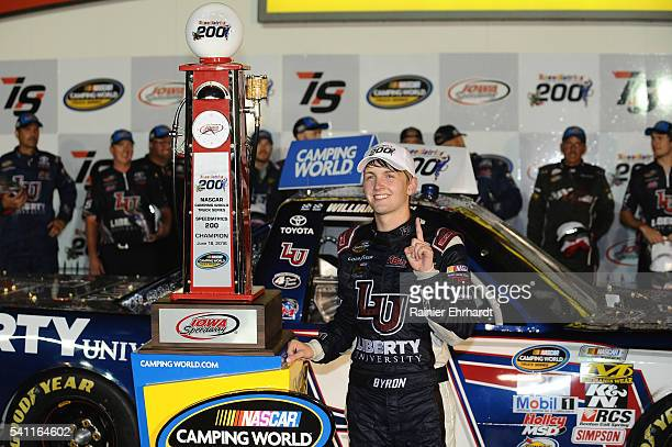 William Byron driver of the Liberty University Toyota celebrates in Victory Lane after winning the NASCAR Camping World Truck Series Speediatrics 200...