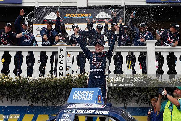 William Byron driver of the Liberty University Toyota celebrates in victory lane after winning the NASCAR Camping World Truck Series Pocono Mountains...