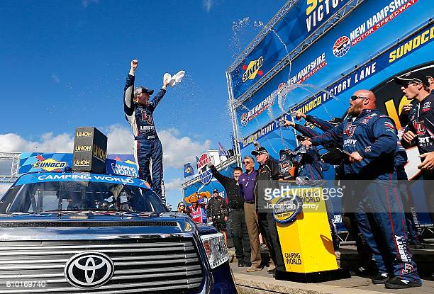 William Byron driver of the Liberty University Toyota celebrates in Victory Lane after winning the NASCAR Camping World Truck Series UNOH 175 at New...