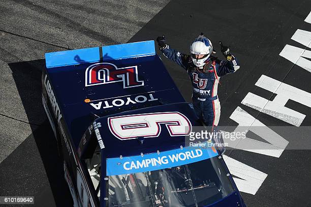 William Byron driver of the Liberty University Toyota celebrates after winning the NASCAR Camping World Truck Series UNOH 175 at New Hampshire Motor...
