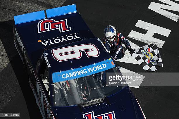 William Byron driver of the Liberty University Toyota celebrates with the checkered flag after winning the NASCAR Camping World Truck Series UNOH 175...