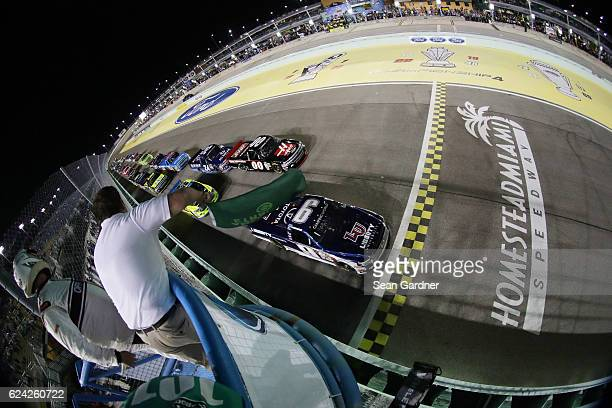 William Byron driver of the Liberty University Toyota leads the field to the green flag to start the NASCAR Camping World Truck Series Ford EcoBoost...