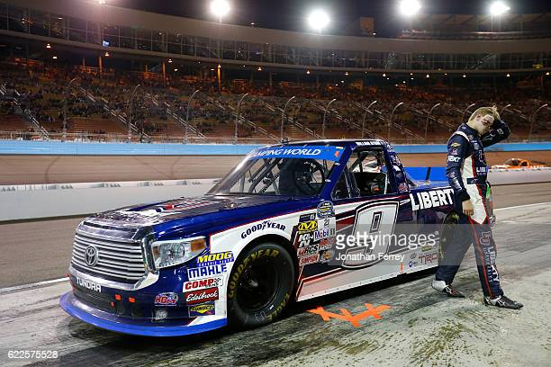 William Byron driver of the Liberty University Toyota reacts to blowing an engine in pit road during the NASCAR Camping World Truck Series Lucas Oil...