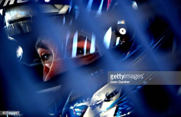 William Byron driver of the Liberty University Toyota sits in his car during practice for the NASCAR Camping World Truck Series Lucas Oil 150 at...