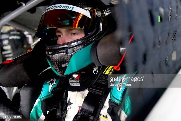 William Byron driver of the UniFirst Chevrolet sits in his car during practice for the Monster Energy NASCAR Cup Series Bank of America ROVAL 400 at...