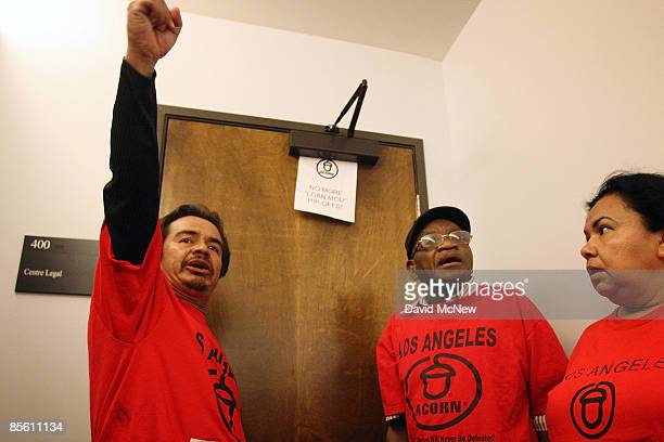 William Cabrera and other homeowners and ACORN activists appear at the door of the new offices of the forprofit loan modification service company...