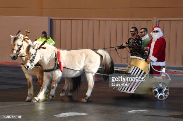 William Carrier of the Vegas Golden Knights dressed as an elf and Ryan Reaves of the Golden Knights dressed as Santa Claus arrive at TMobile Arena to...