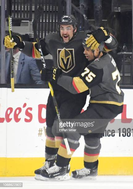 William Carrier and Ryan Reaves of the Vegas Golden Knights celebrate after Carrier scored a firstperiod goal against the St Louis Blues during their...