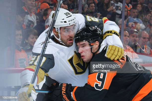 William Carrier of the Vegas Golden Knights and Ivan Provorov of the Philadelphia Flyers scrum in the corner at the Wells Fargo Center on October 13...
